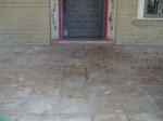 Mexican Saltillo paver tile with peeling sealer, water damage and heavy sealer build-up.