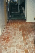 Interior brick floor with water damage from flood.
