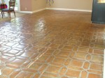 Mexican Saltillo paver tile with tape damage and heavy sealer build-up.