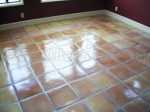 Mexican Saltillo paver tiles completely stripped to bare tile and sealed with medium shine sealer.