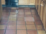 Mexican Saltillo pavers with dis-colored grout and years of heavy sealer build-up.