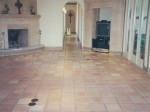 Mexican Saltillo paver tile with dull and worn sealer.