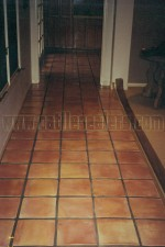 Mexican Saltillo paver tiles completely stripped to bare tile, acid washed and sealed with high gloss sealer / polish.